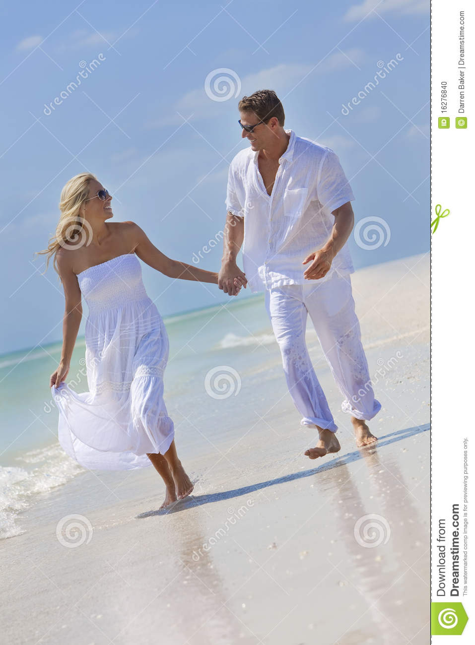 71437a9cef5 Happy Couple Holding Hands On A Tropical Beach Stock Photo - Image ...