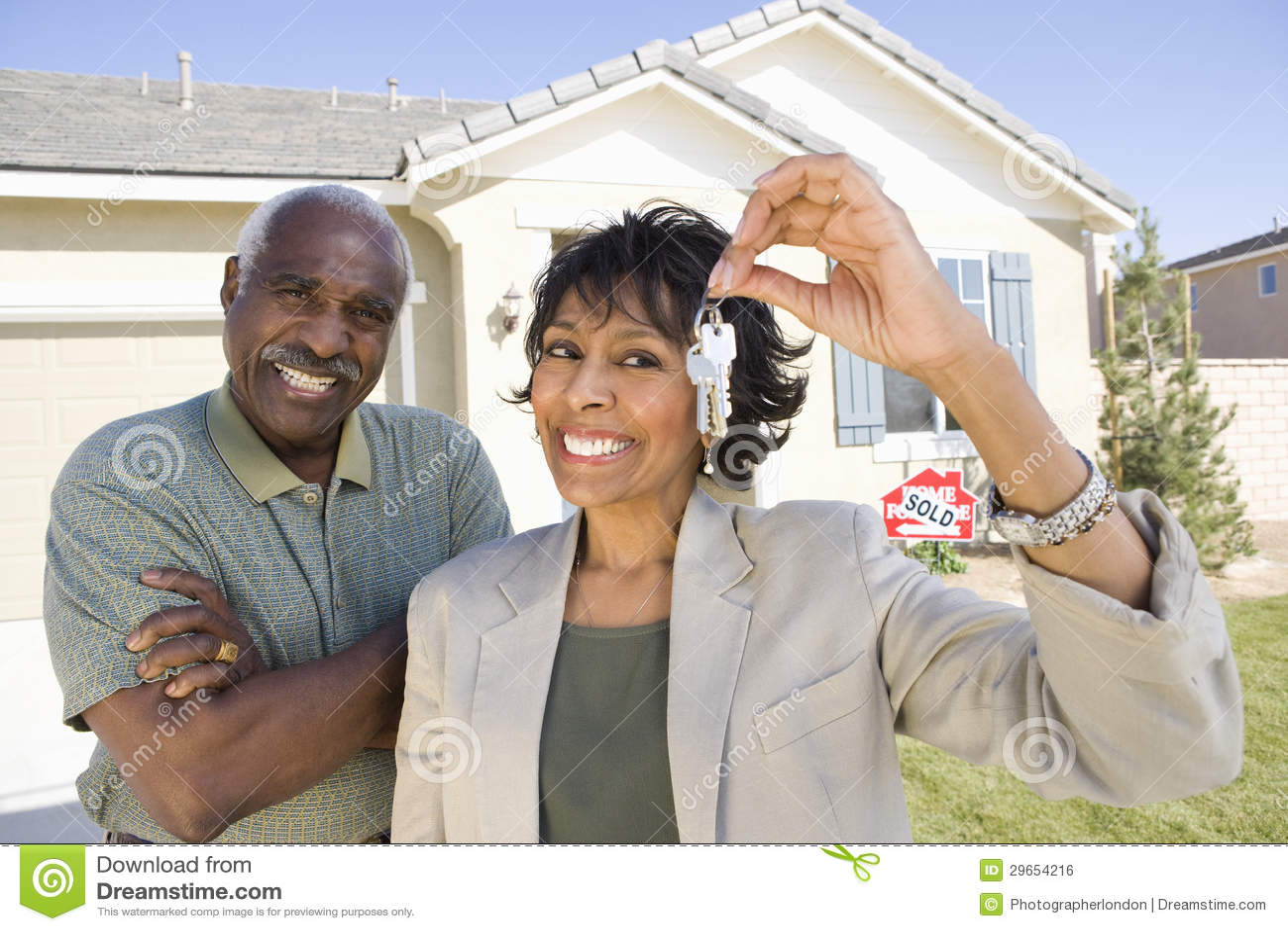 Happy Couple Holding New Home Key