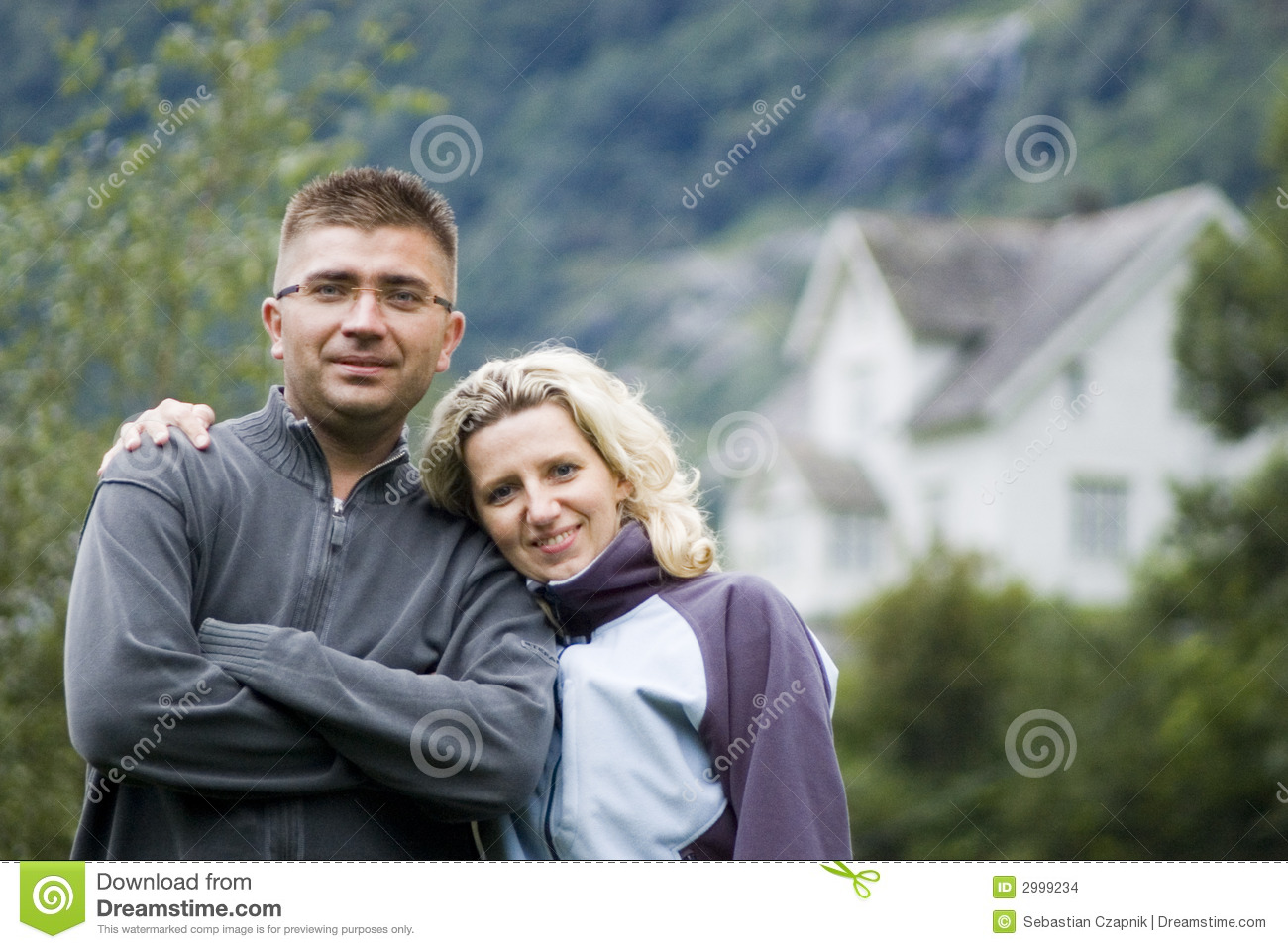 Happy couple and house