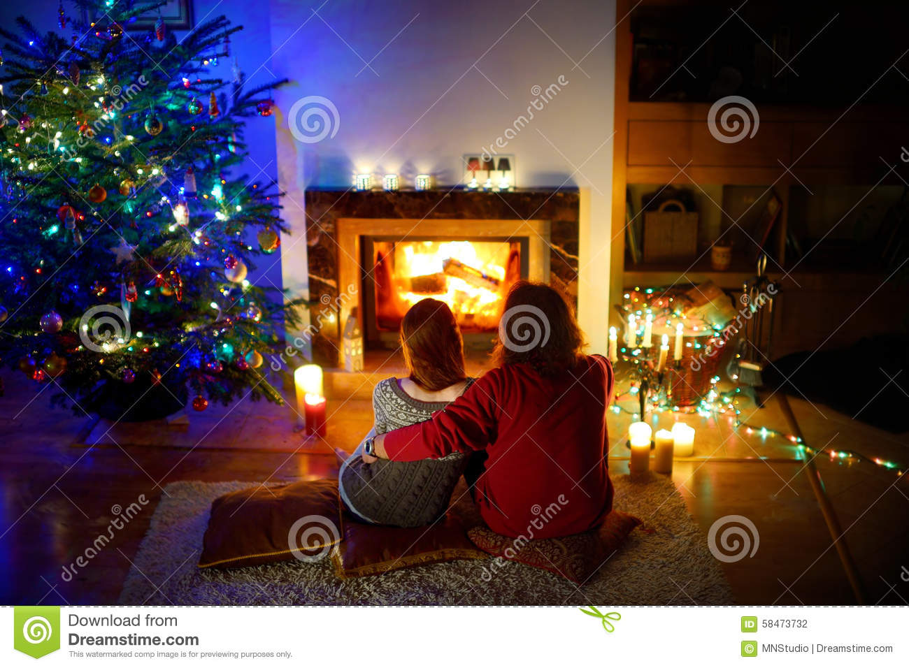 christmas couple cozy dark eve fireplace happy laying living room