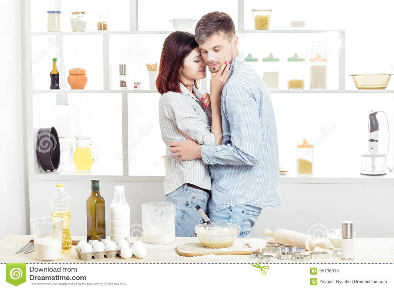 Happy Couple In Love Cooking Dough And Kissing In Kitchen Stock ...