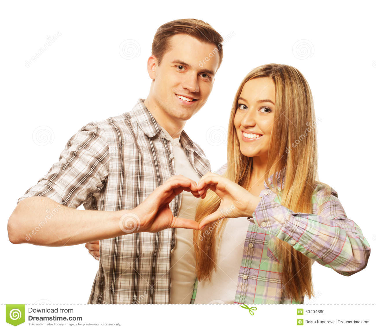 Showing Love: Happy Couple In Love Showing Heart With Their Fingers