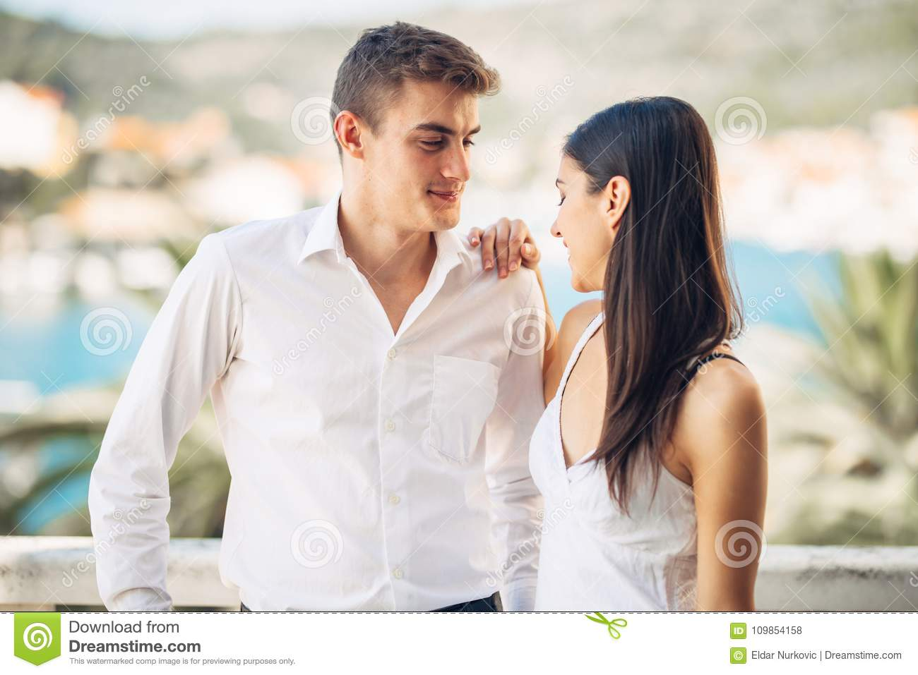 Happy couple in love on a summer holiday vacation.Celebrating holiday,anniversary,engagement. Woman laughing at a joke