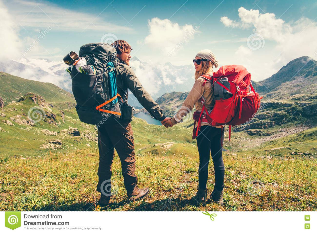 Happy couple man and woman backpackers together stock for Couples vacations in usa