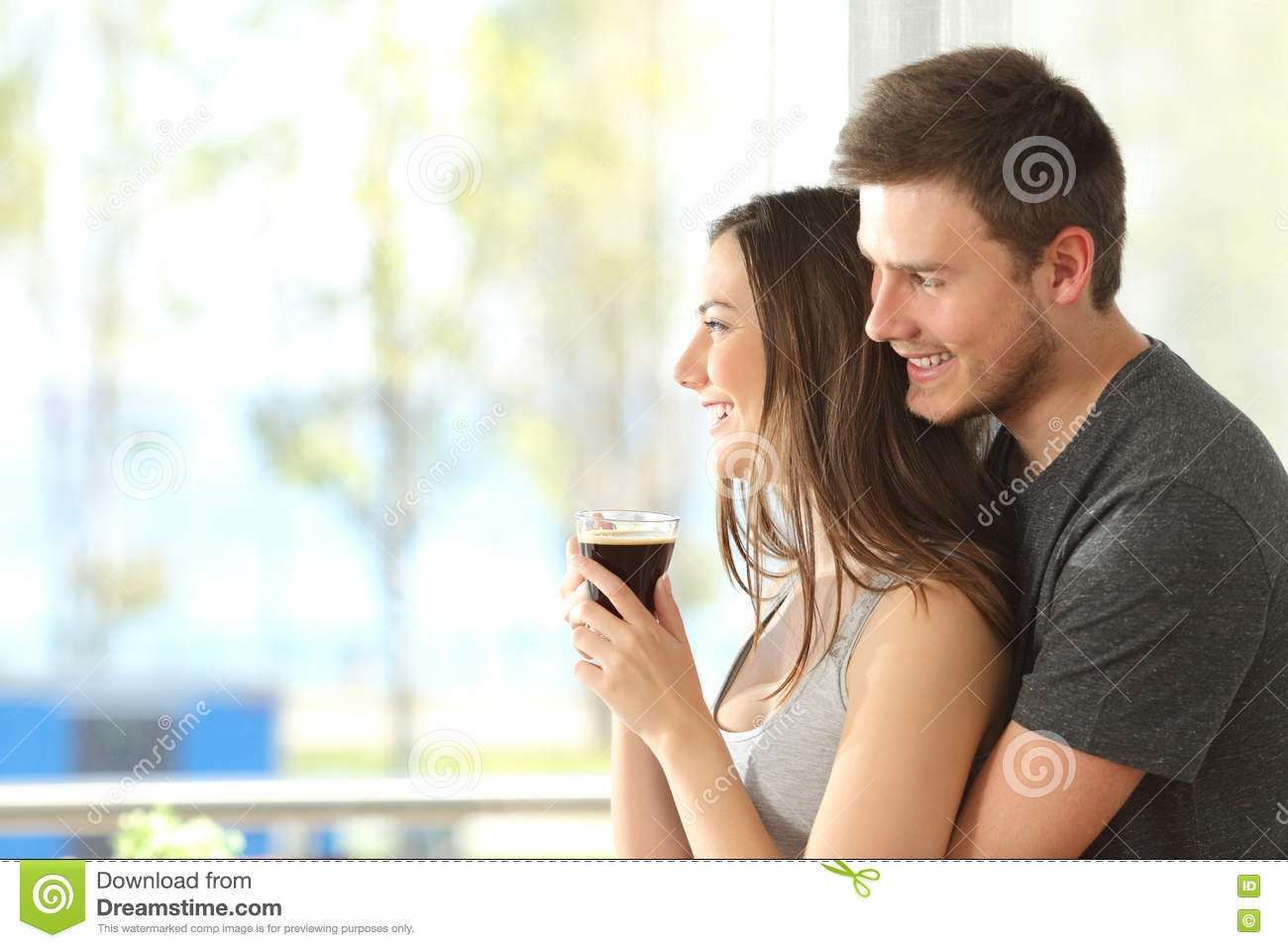 Happy couple or marriage looking through window