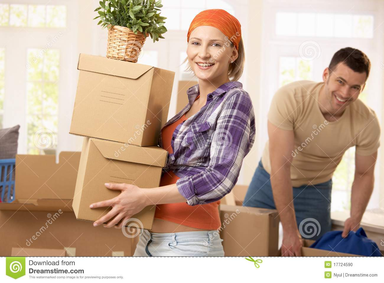Happy couple moving house stock photo image 17724590 When is the best time to move house