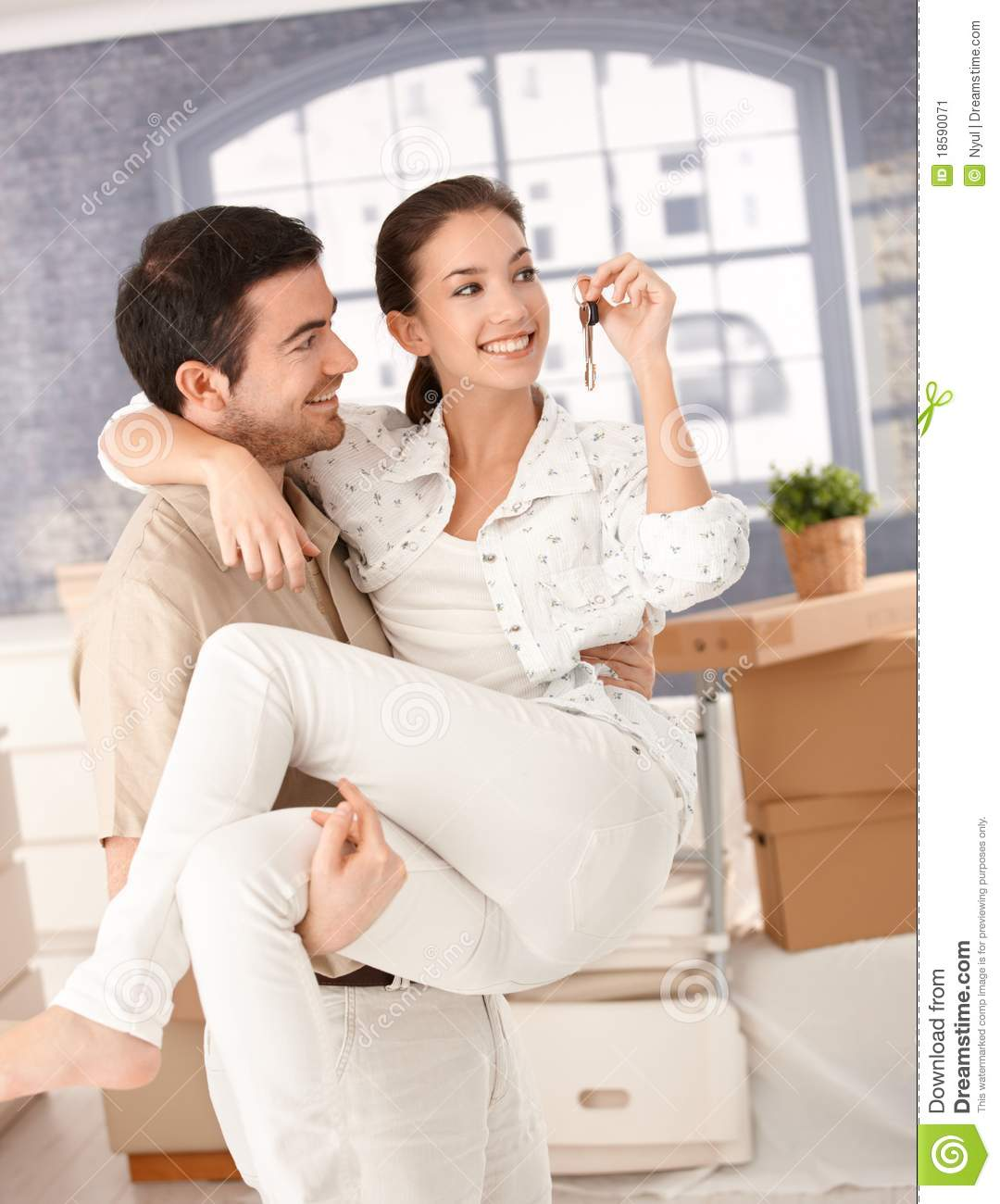 Happy couple moving to new home smiling stock image image 18590071 - Young couple modern homes ...