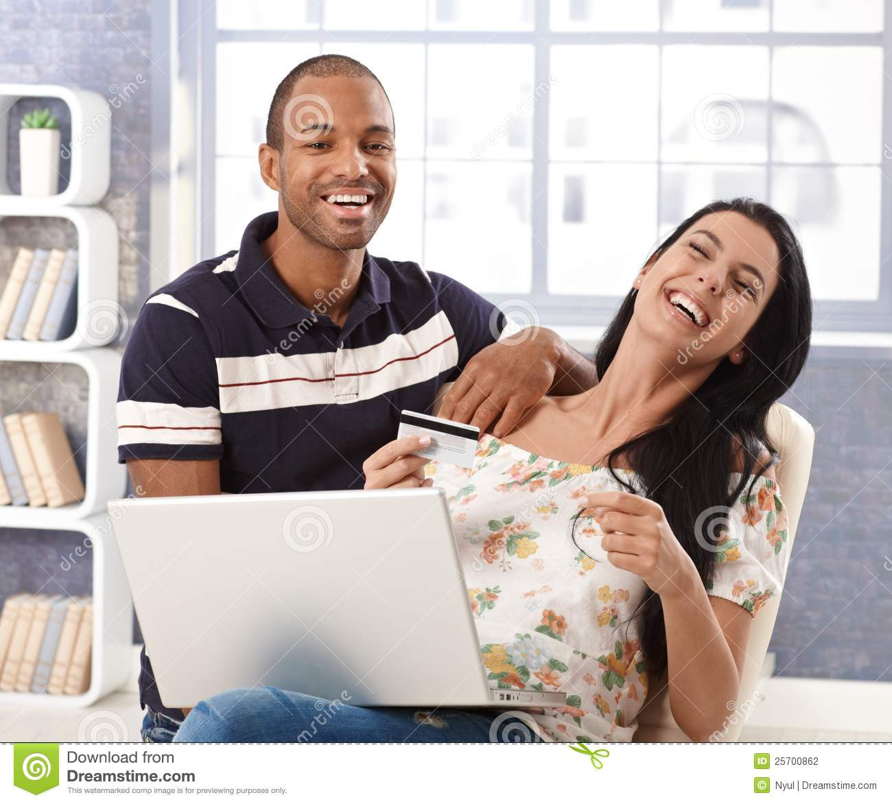 happy couple online shopping at home laughing stock photo image of couple hair 25700862. Black Bedroom Furniture Sets. Home Design Ideas