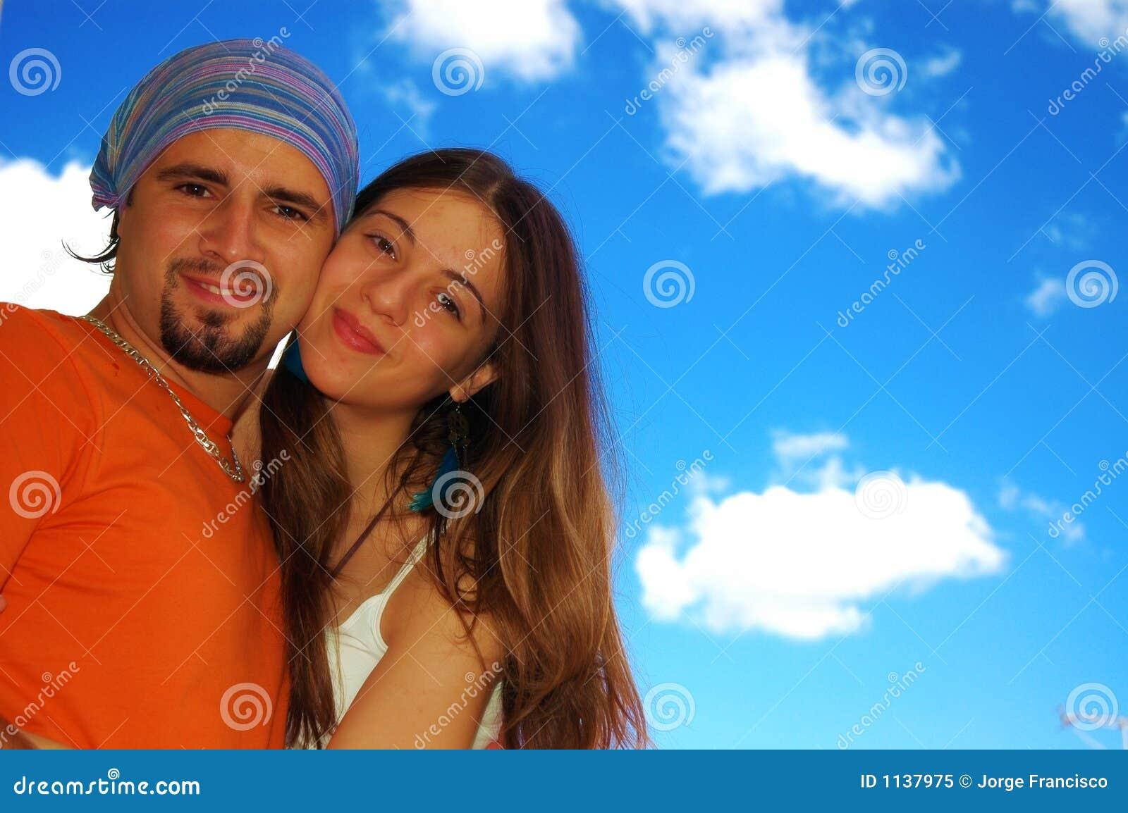 Happy couple outdoors.