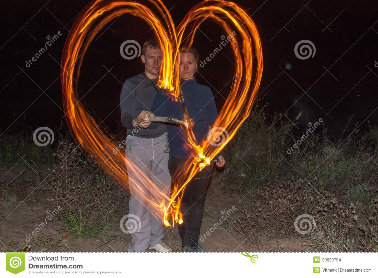 Happy Couple Painting The Heart Flames Of Fire As A Symbol Of Love