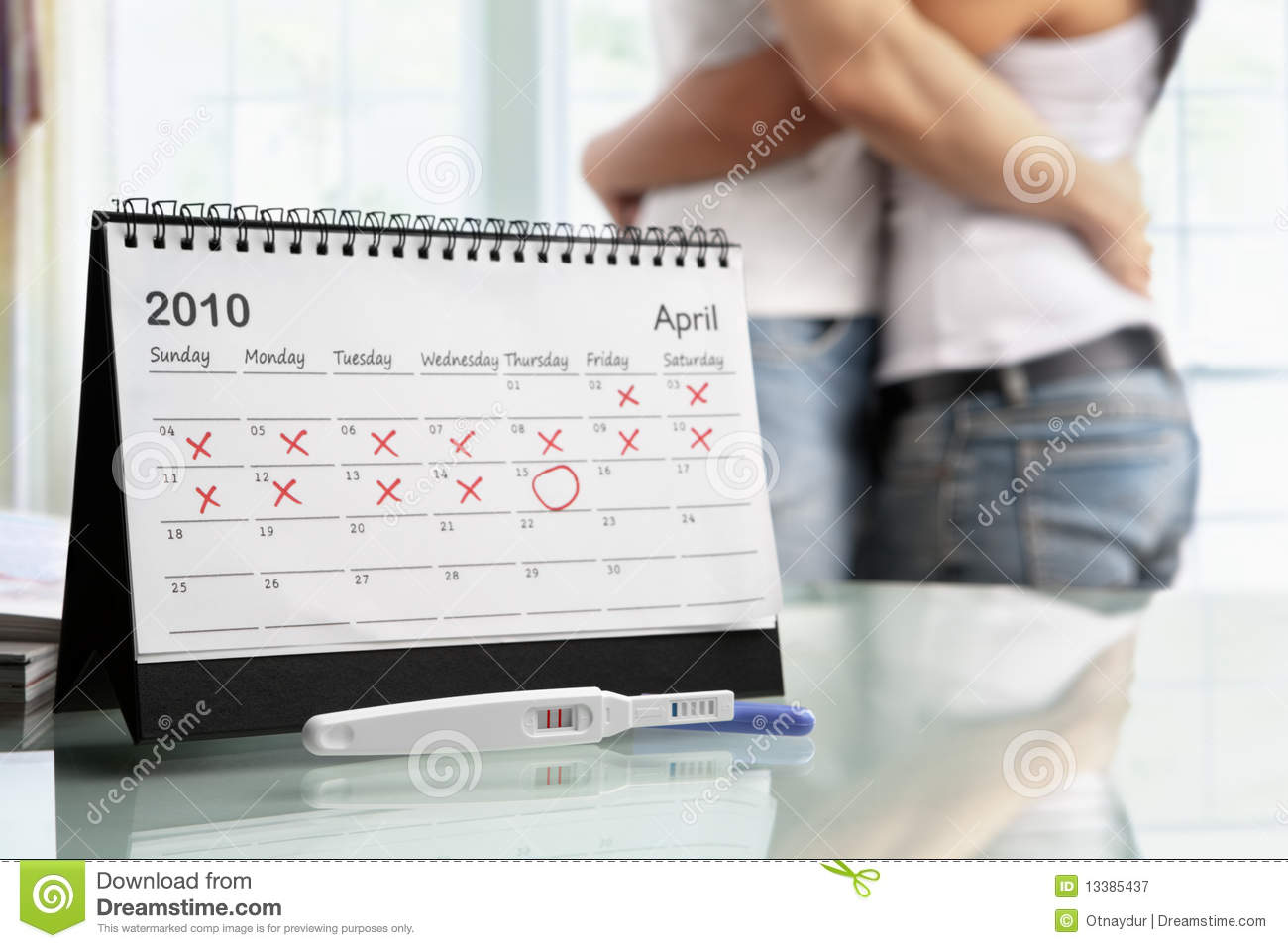 Happy couple with positive pregnancy test