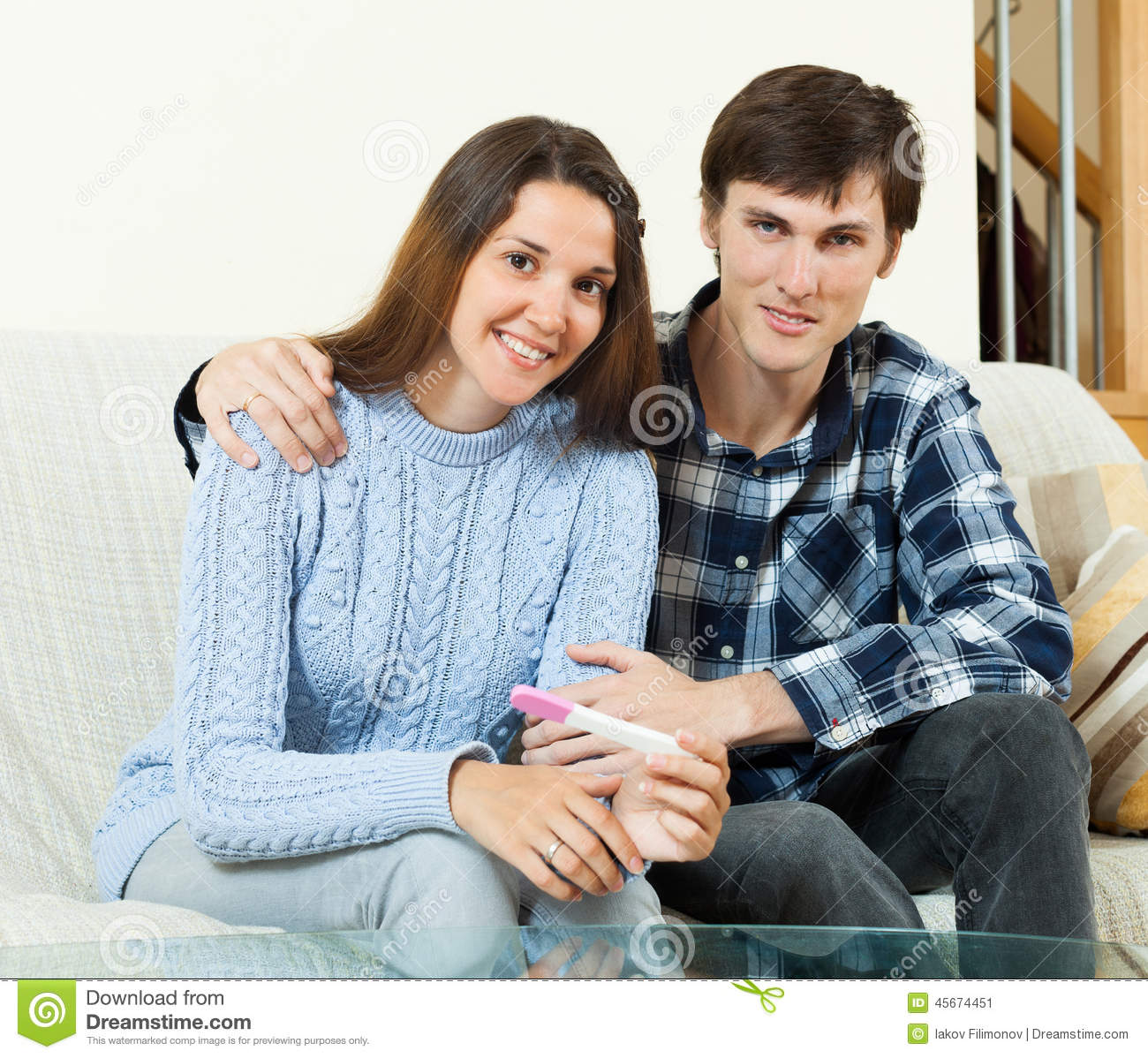 happy couple with pregnancy test stock photo image 45674451. Black Bedroom Furniture Sets. Home Design Ideas
