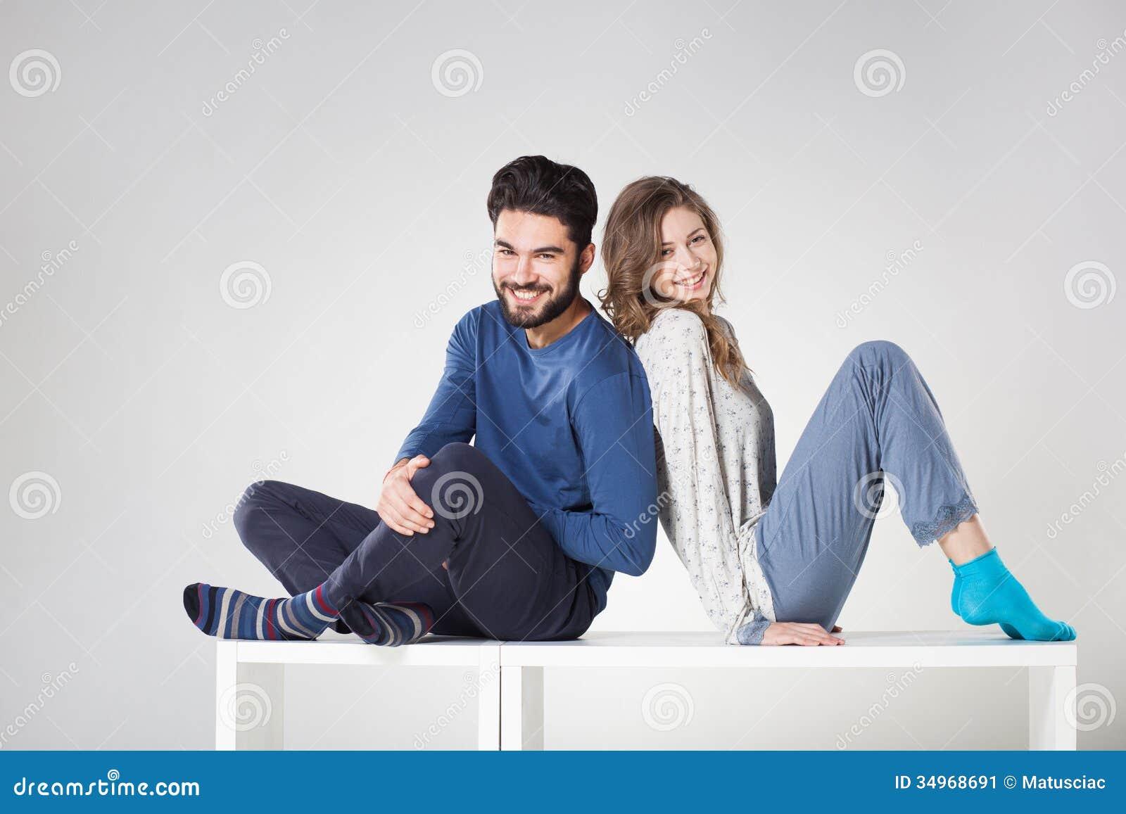 Happy Couple In Pyjama Posing In The Studio Stock Image