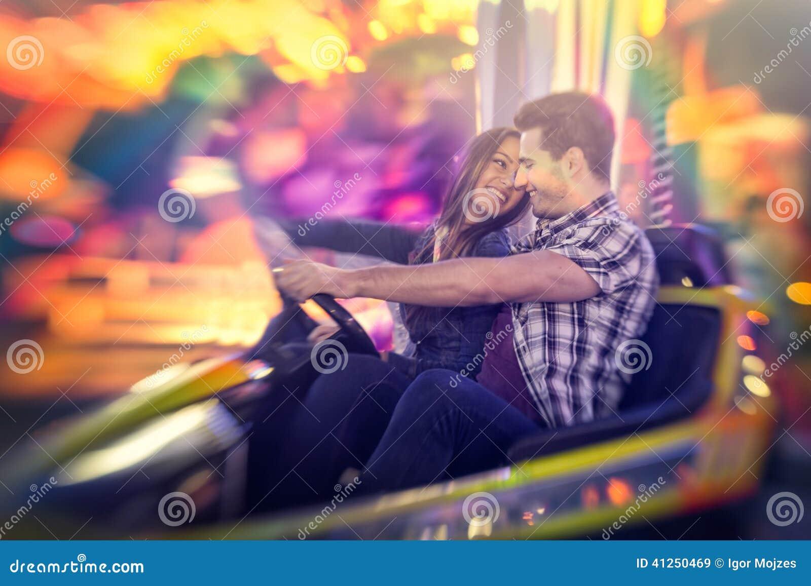 Happy couple ride bumper car