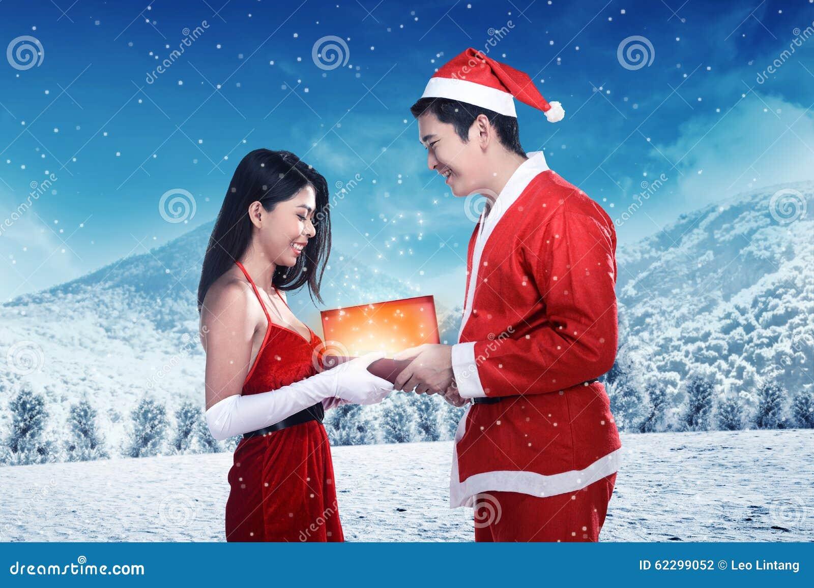Happy Couple In Santa Claus Costume Celebrate Christmas