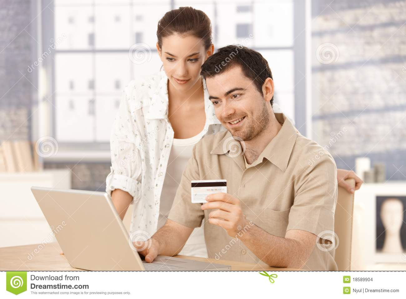 Happy couple shopping online at home smiling stock images for Online shopping for the home