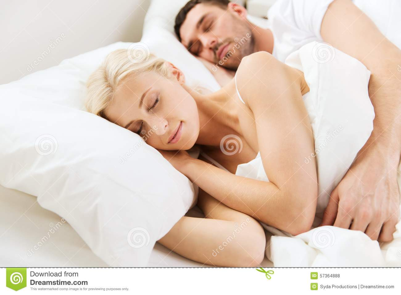 happy-couple-sleeping-bed-home-people-rest-relationships-happiness-concept-57364888.jpg