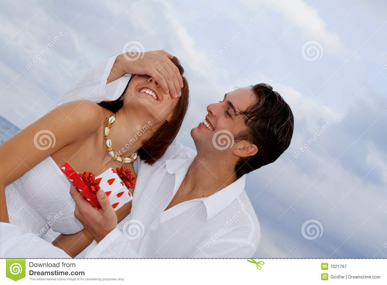 Happy couple with surprise gift