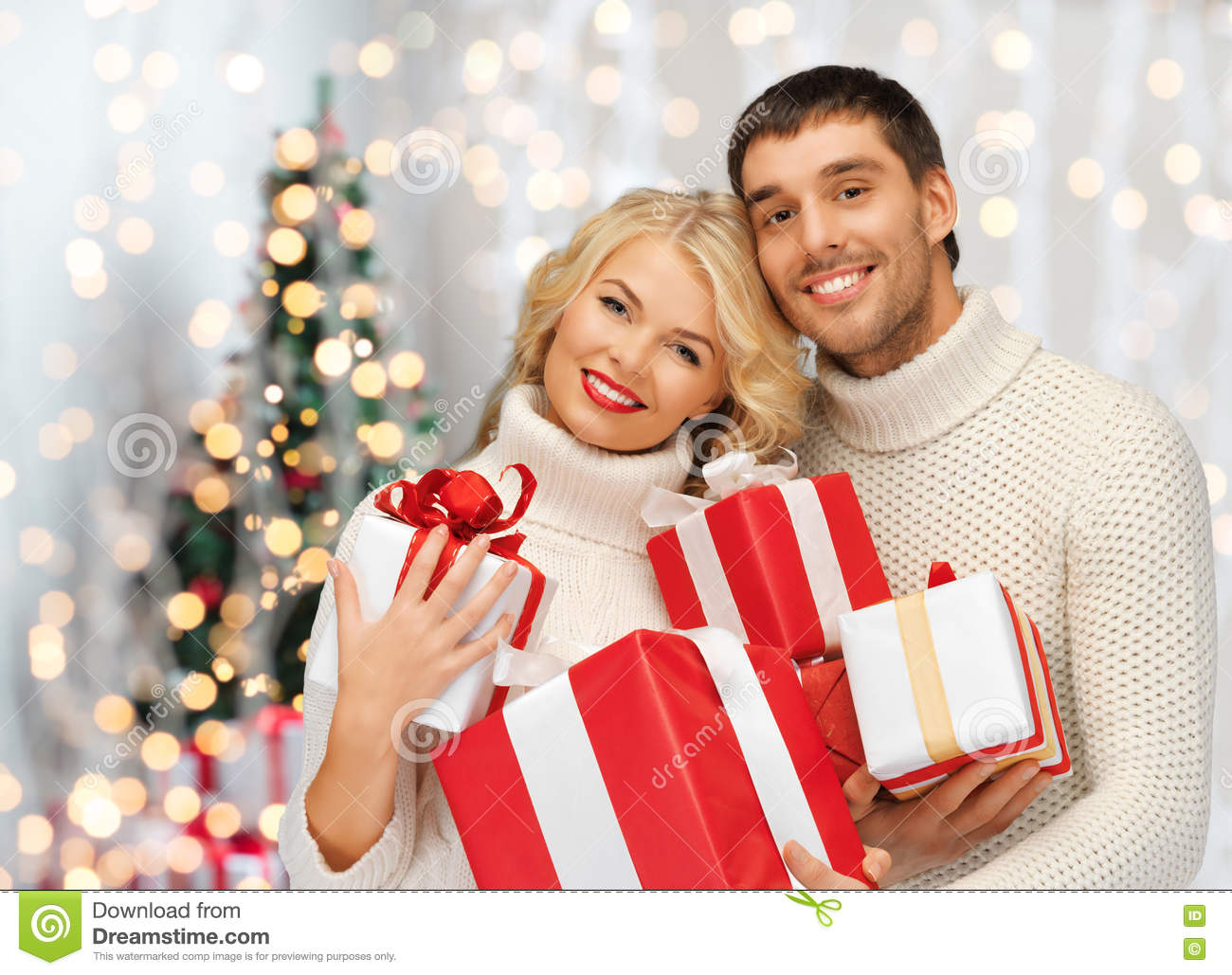 Happy Couple In Sweaters Holding Christmas Gifts Stock ...