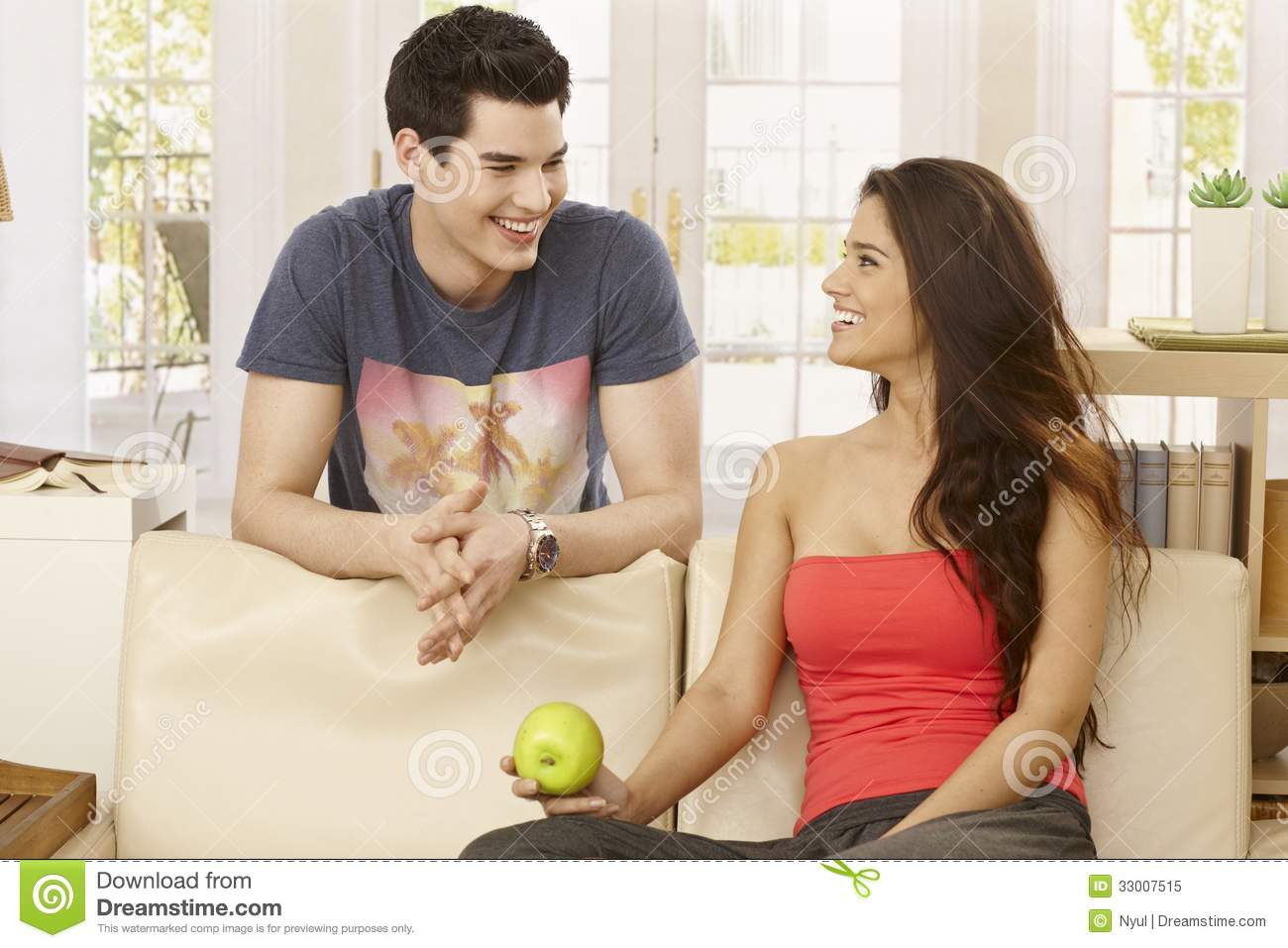 Happy couple talking at home royalty free stock photo image 33007515 - Young couple modern homes ...