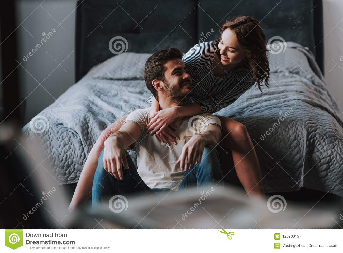Happy Couple Together Having Fun In Bedroom Stock Image