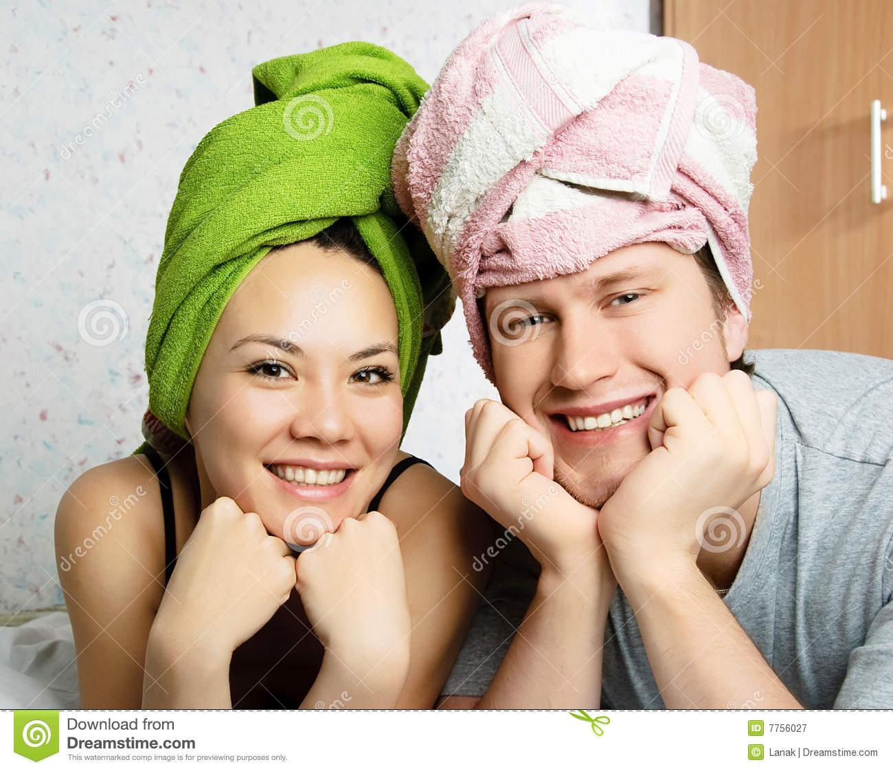 Happy couple with towels on their heads