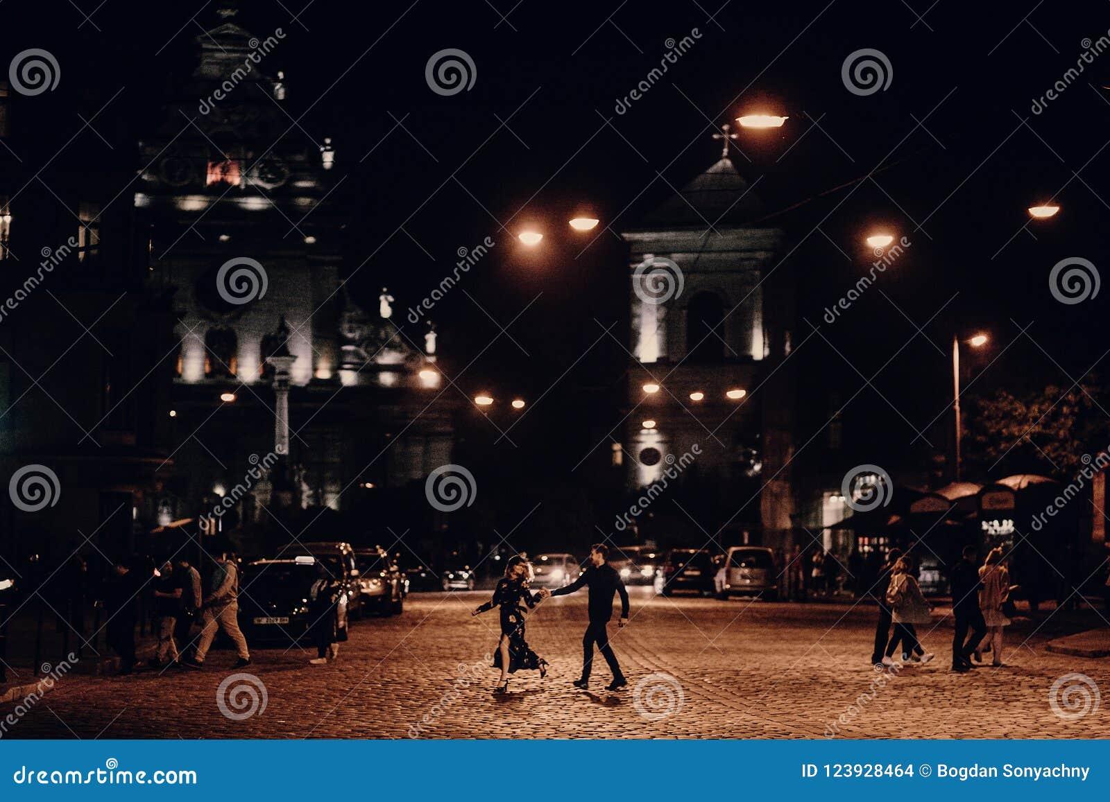 Happy Couple On A Walk In European Street On Their Honeymoon Be