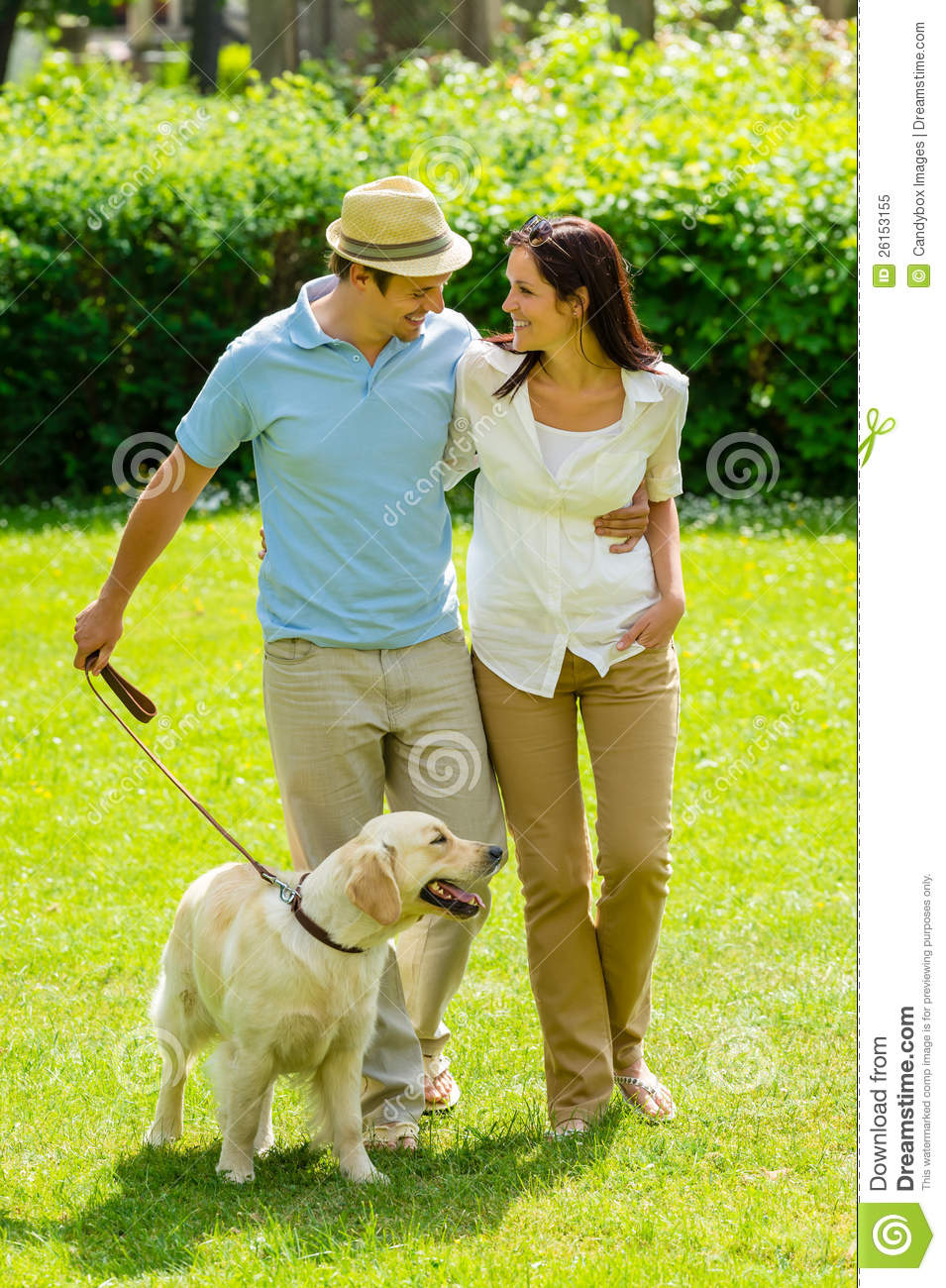 Happy Couple Walking Dog On Park Lawn Royalty Free Stock ... Relaxing Dog Music