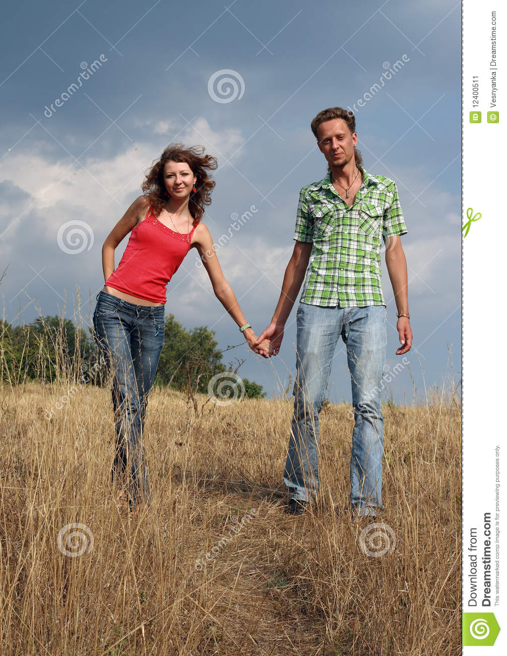 Happy Couple Walking On A Field Stock Image Image 12400511