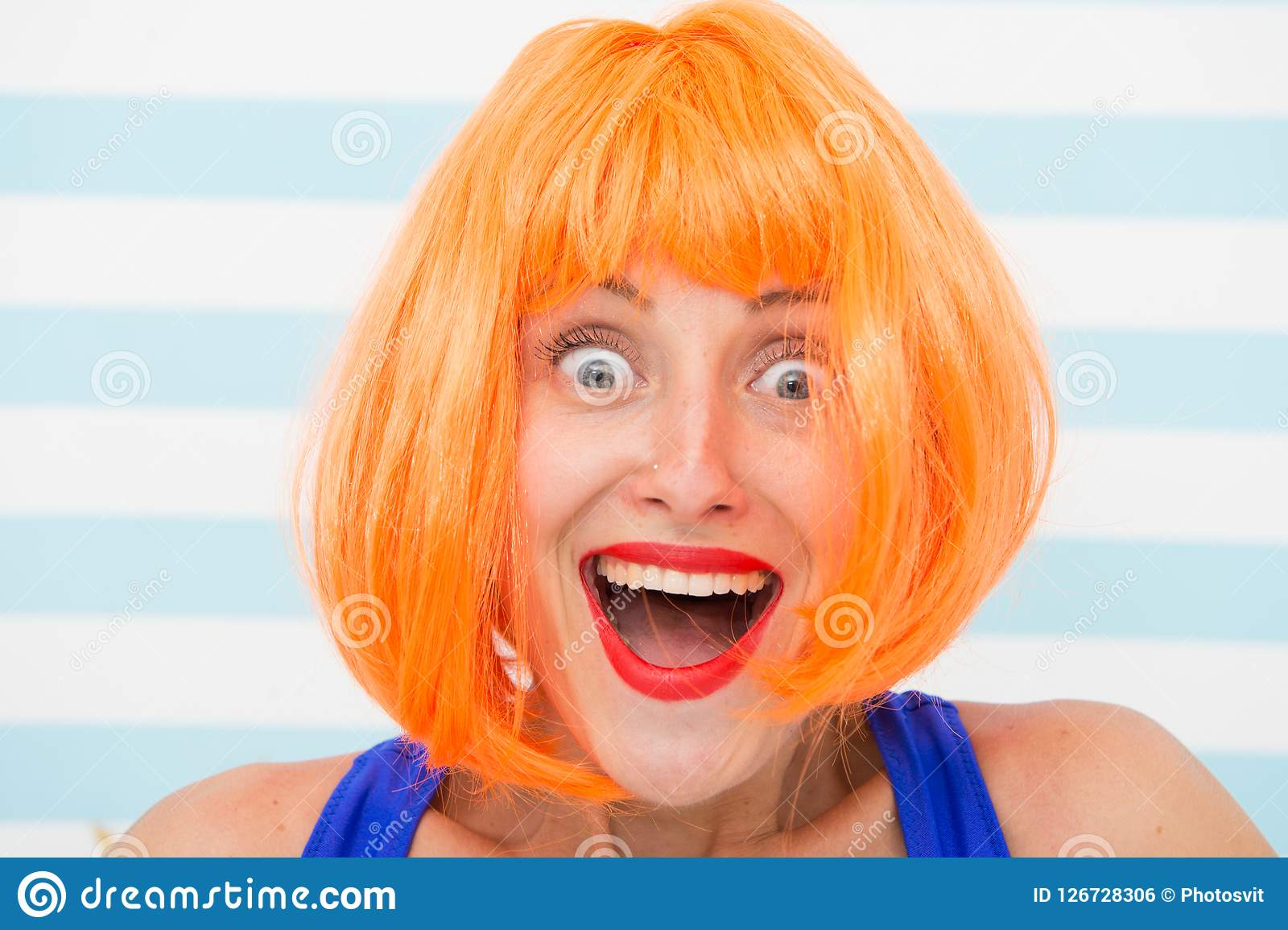 Happy crazy girl with omg or wow facial expression. happy girl with crazy look. wow. surprised happy girl with orange