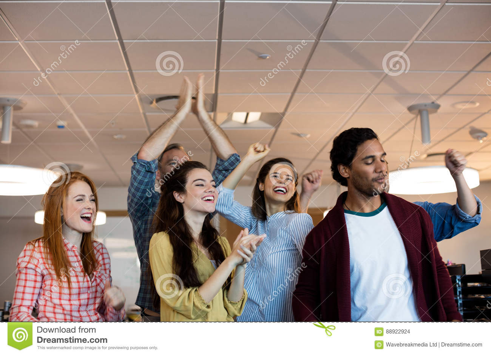 Happy creative business team celebrating success