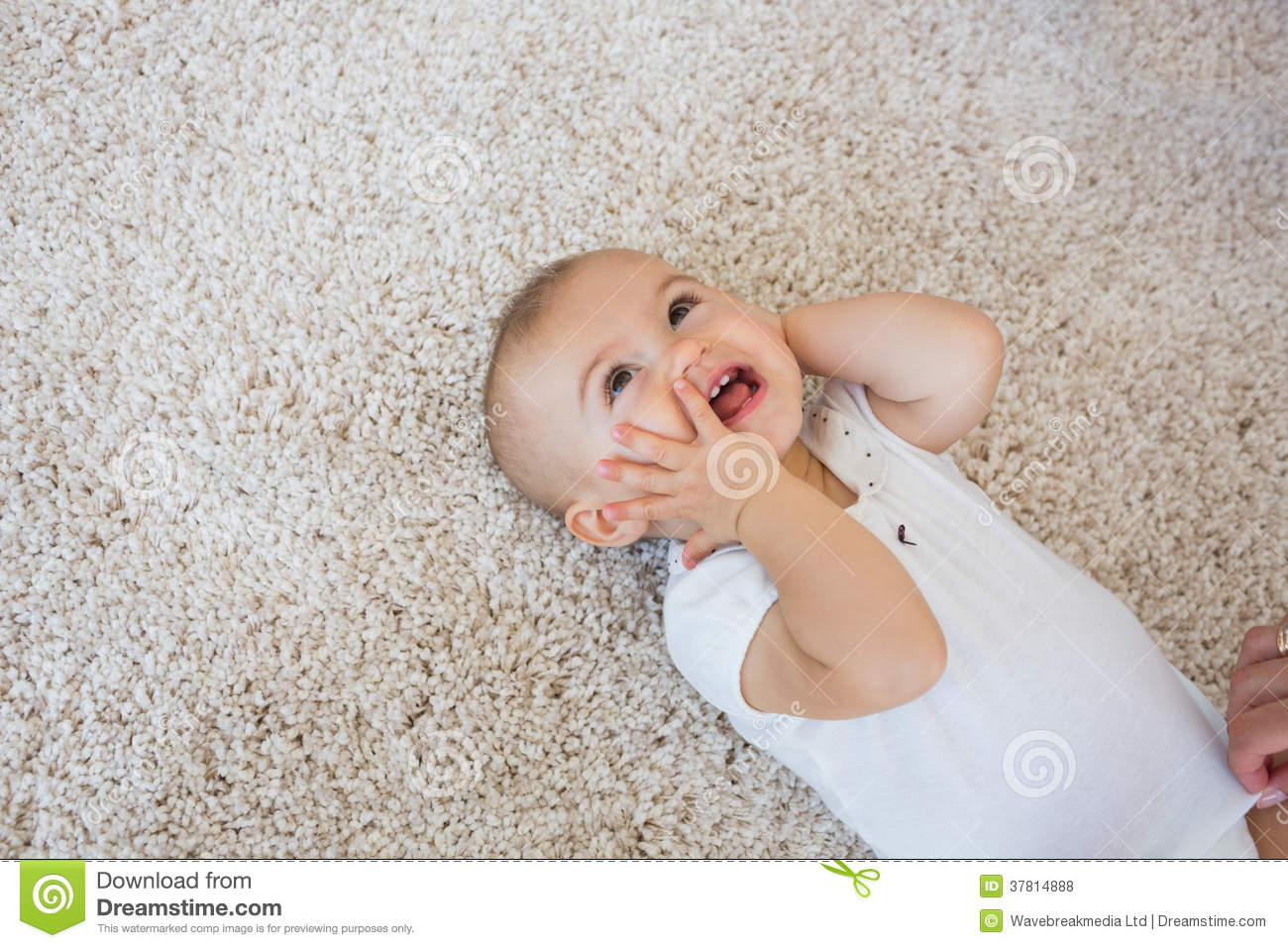 Happy Cute Baby Lying On Carpet Royalty Free Stock Photos