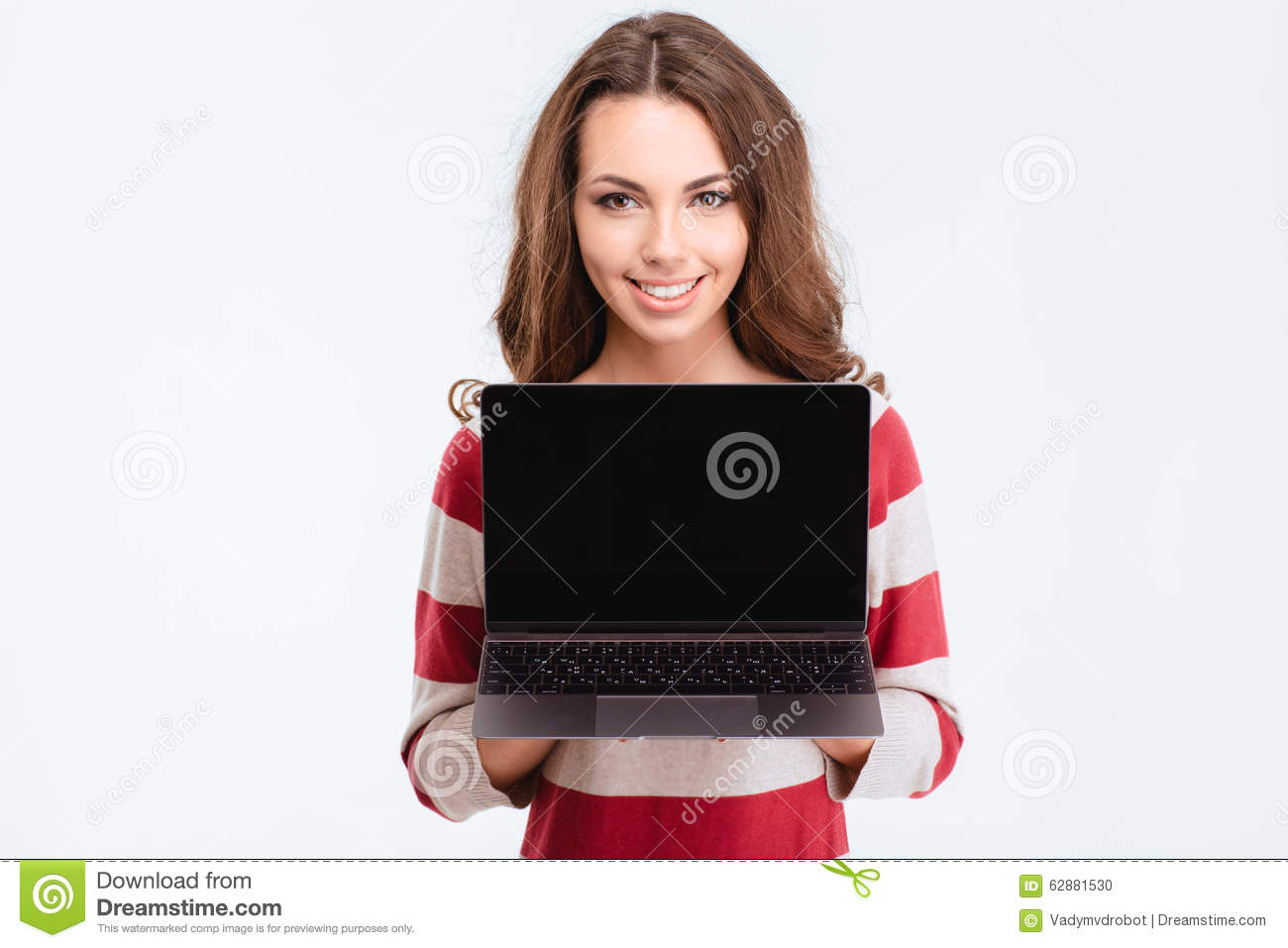 Happy cute woman showing blank laptop compter