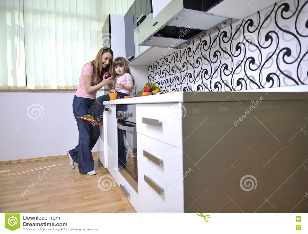 Happy Daughter And Mom In Kitchen Royalty Free Stock