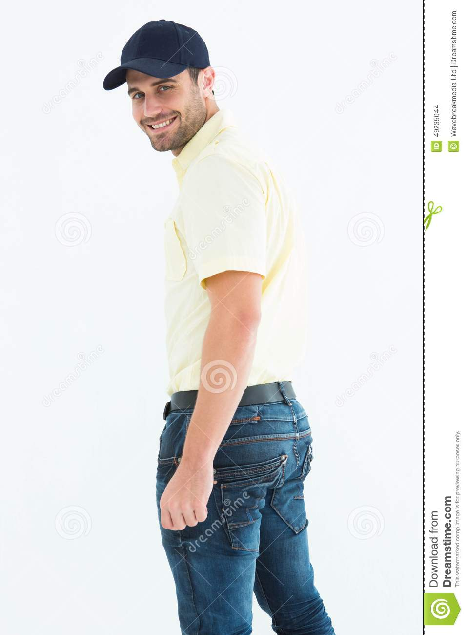 b02c388093ddc Portrait of happy delivery man wearing baseball cap on white background
