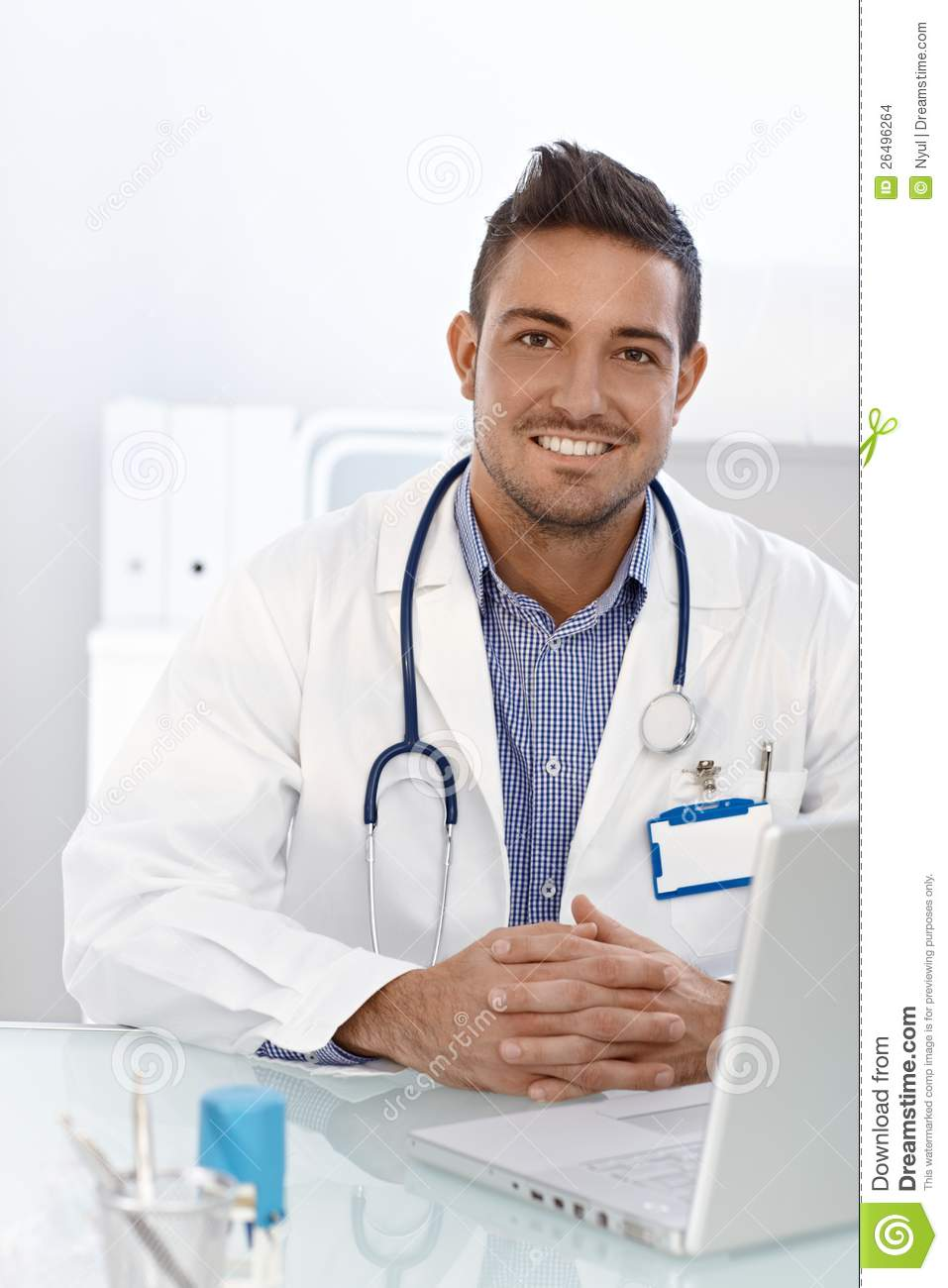 Happy Doctor Sitting At Desk Stock Images Image 26496264
