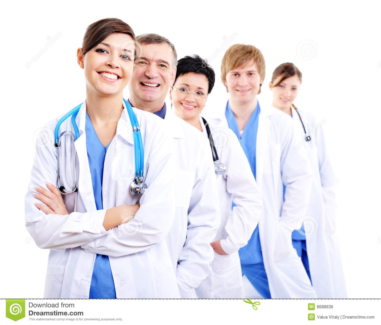 Happy Doctors In Hospital Gowns In Row Royalty Free Stock