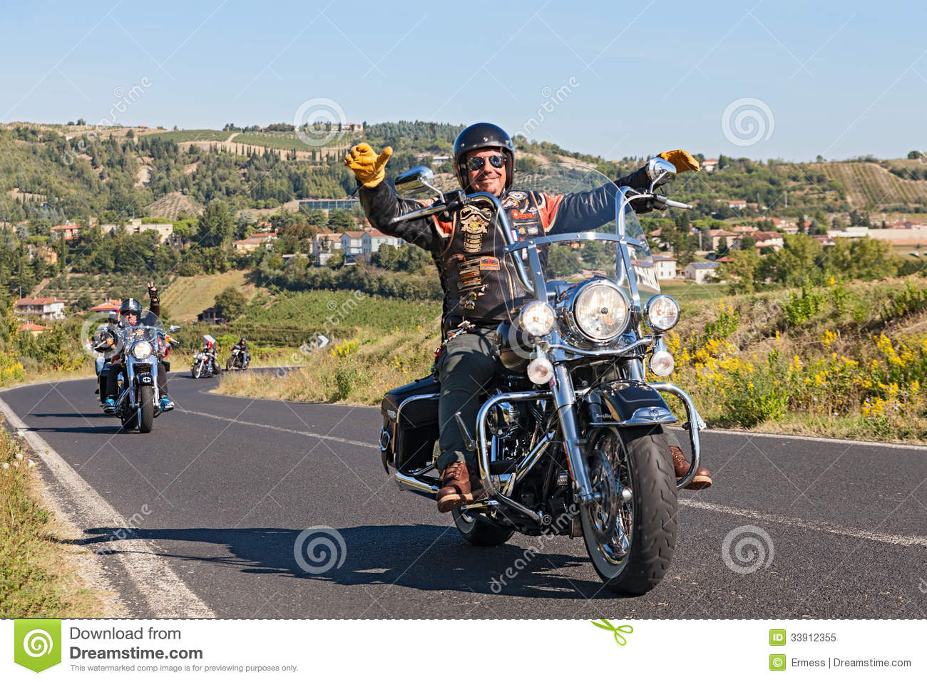 driver leads a group of bikers riding Harley Davidson at motorcycle ...