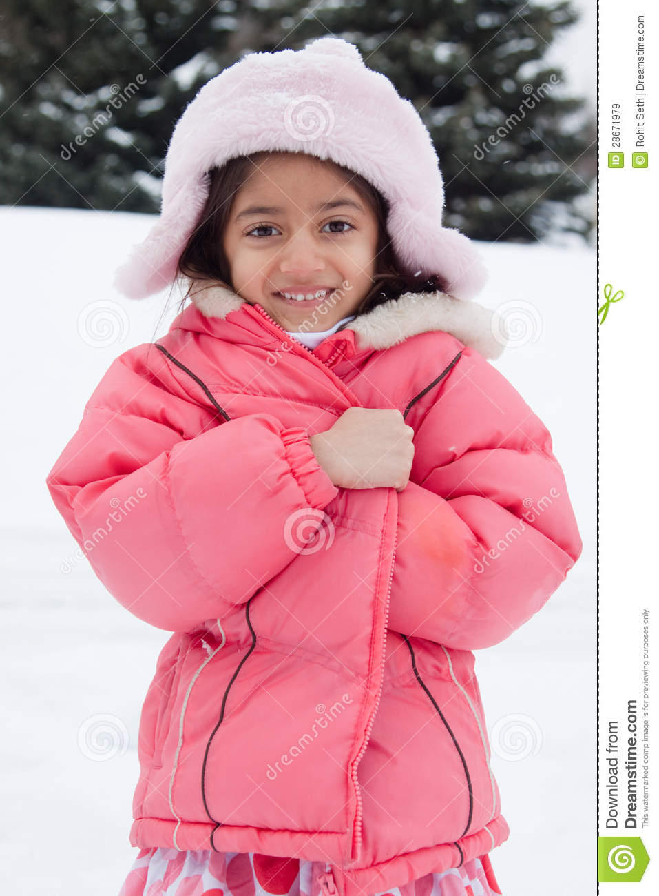 Happy East Indian Girl Playing In The Snow Stock Image