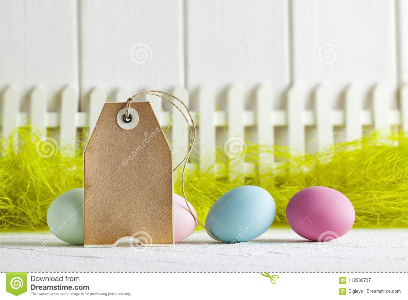 Happy Easter - Blank paper label and colored eggs