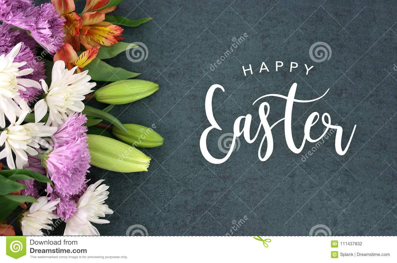 Happy Easter Calligraphy Holiday Script With Colorful Spring Flowers Over Blackboard Background Texture