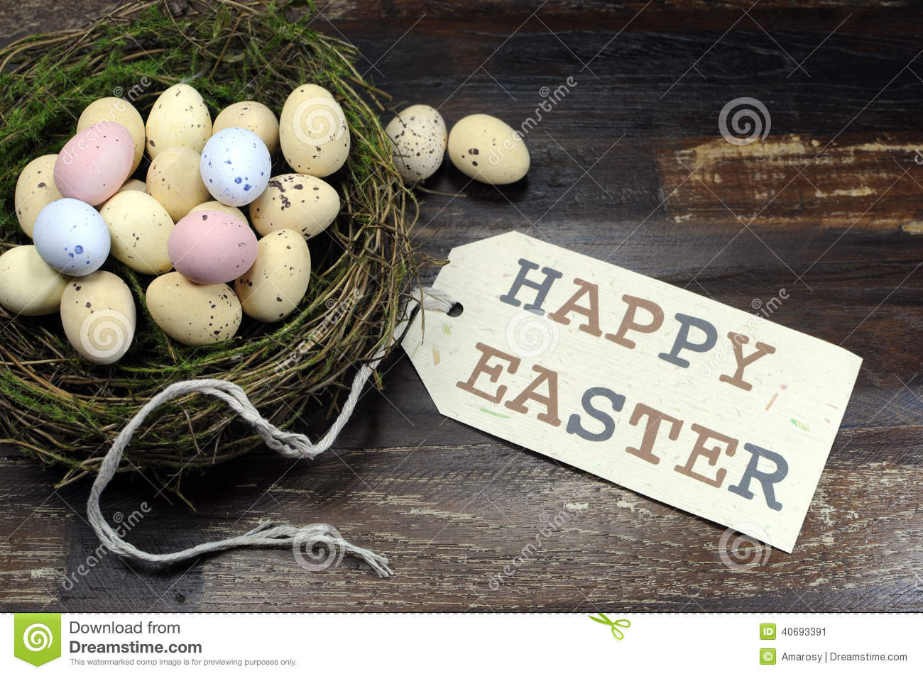 Happy Easter Candy Eggs In Birds Nest On Dark Vintage Recycled Wood With Tag