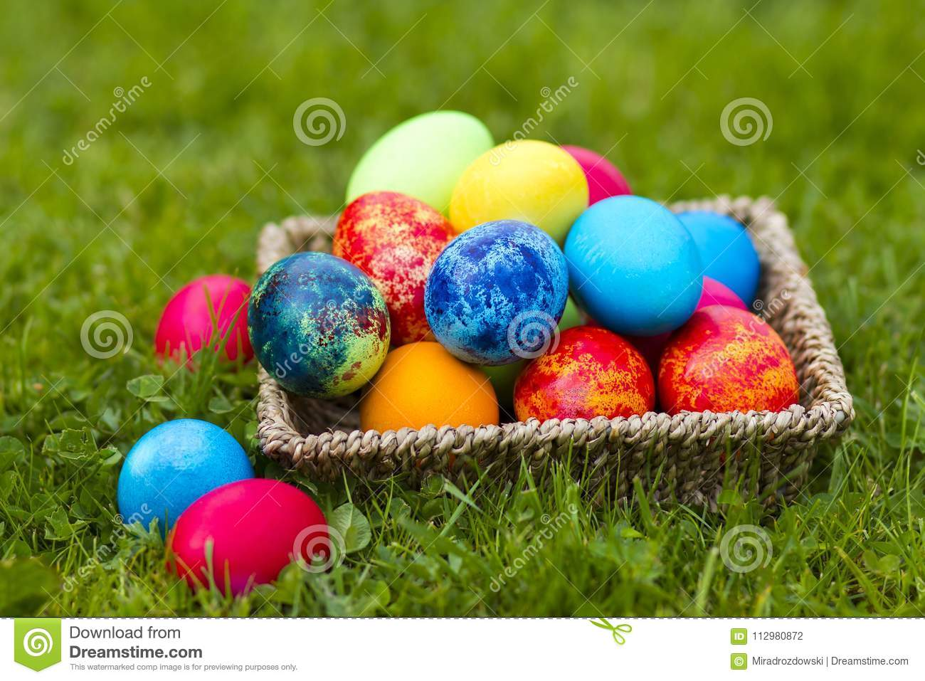 Happy Easter, colorful eggs in a basket