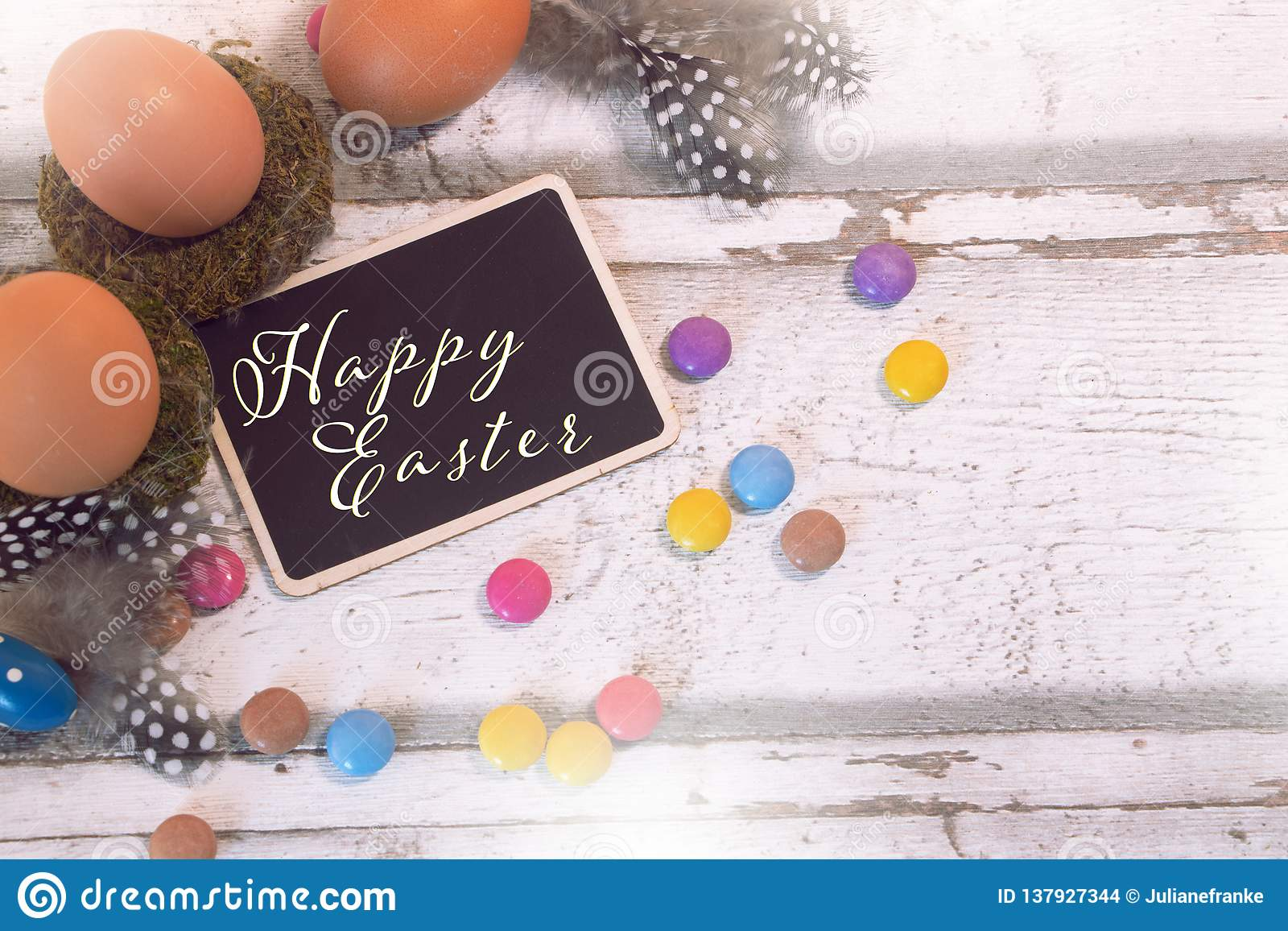 Happy easter decoration with blackboard and eggs