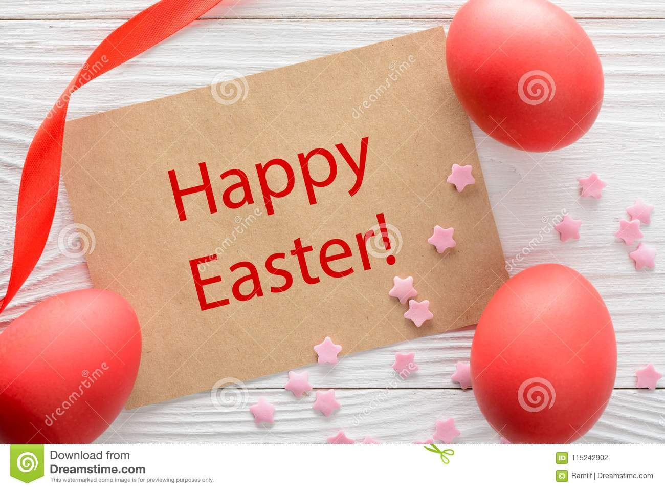 Happy Easter greeting card and colorful eggs on the wooden table. Top view