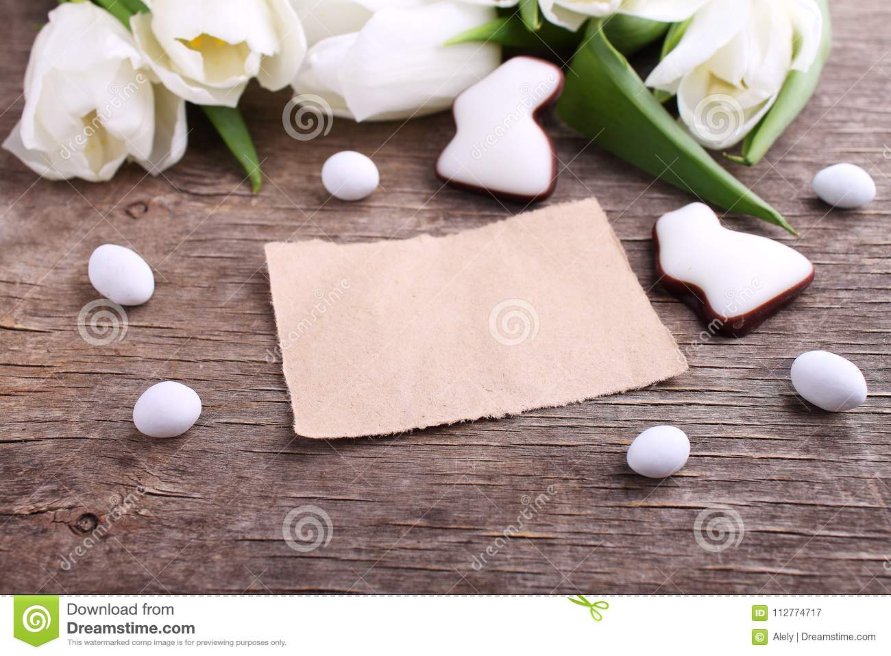 Happy Easter greeting card with white tulip and chocolate eggs and bunny