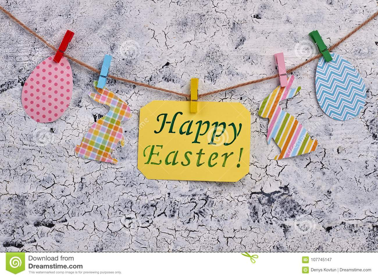 Happy Easter message and paper figurines.