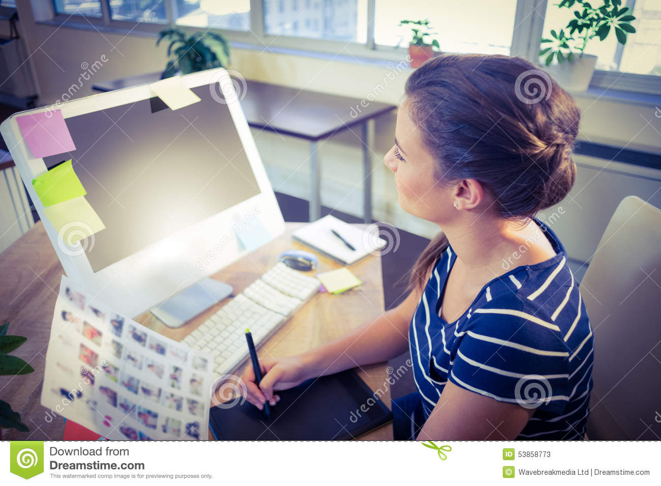 Happy editor working at her desk