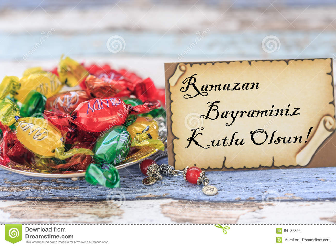 Happy Eid Al Fitr In Turkish On The Card With Candies On Vintage