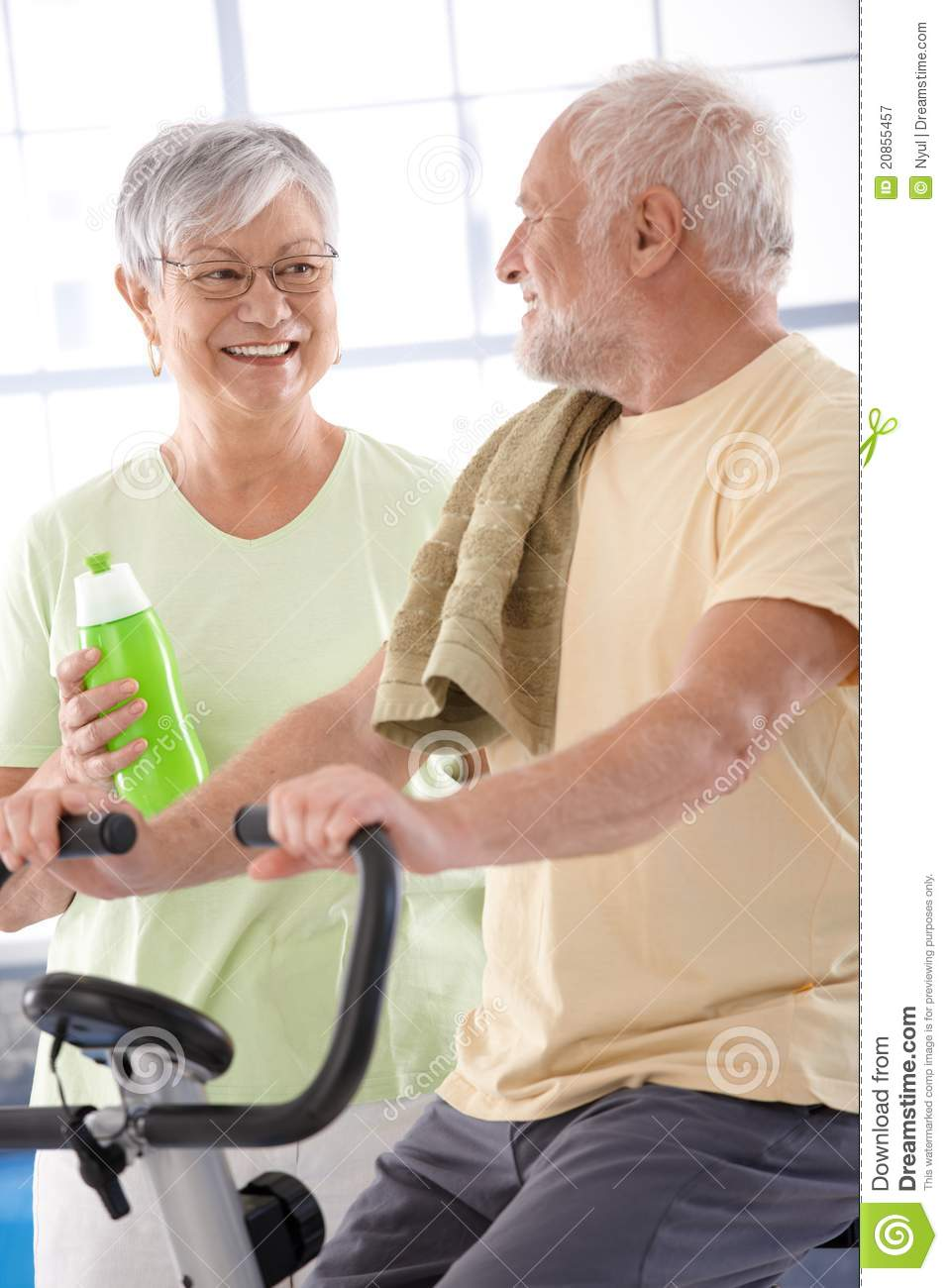 Happy elderly couple in the gym stock image image of gray